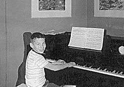 Stephen Schwartz at age seven at the piano