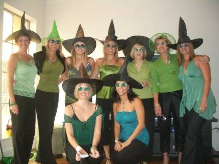 Wicked Partygoers in Elphaba hats and Green Glasses